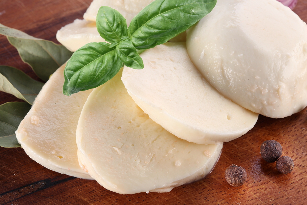 Mozzarella-cheese-and-basil-on-a-wooden-board-